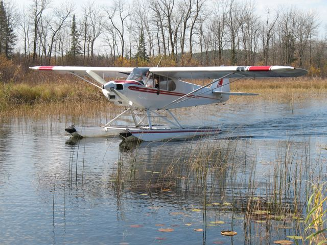 float plane on water with fast coating on floats